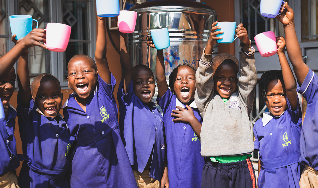 kids with safe drinking water