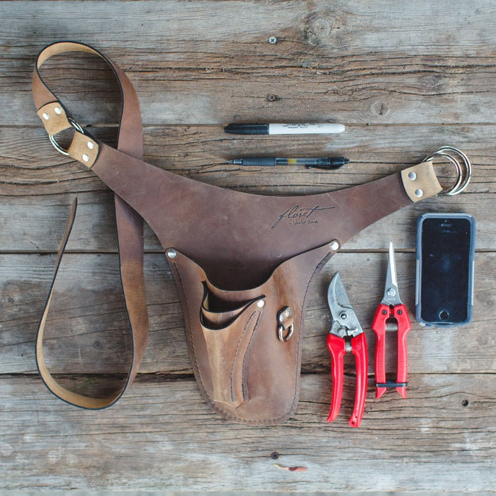 room for both heavy-duty pruners and flower snips or scissors, a cellphone, a pen and pencil and a rose stripper or hand towel, this tool belt has been a total game changer.