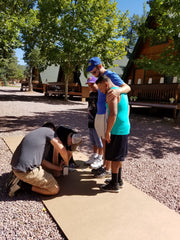 Family and friends putting the walkway together - Sweet Wedding - DIY wedding planning - September 2016 - Cabins on Strawberry Hill - Arizona - picture by owners of Silverrose Bakery