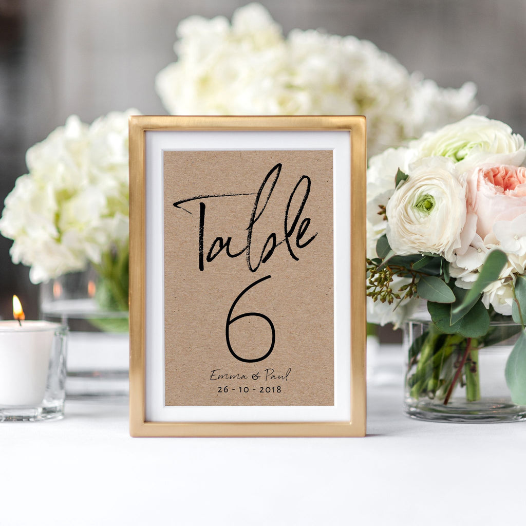 Black Handwriting on Kraft Card Table Numbers