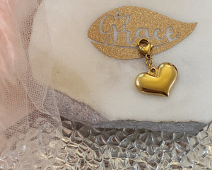 Strong golden heart charm