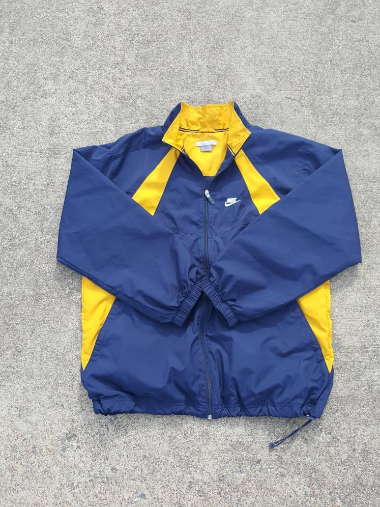 e8a5c46ac0 Vtg NIKE Swoosh Blue Yellow Windbreaker Jacket Sz XL ...