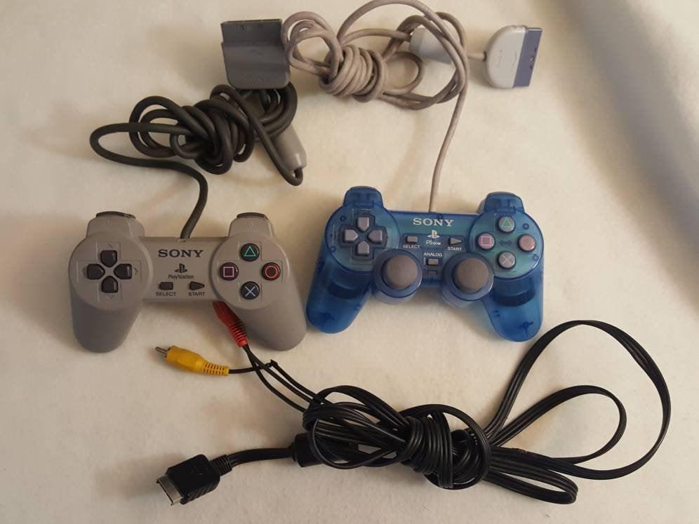 Two Vintage sony PlayStation  2  controllers +  A/V Cable bundle