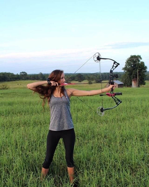 Aly shooting her bow