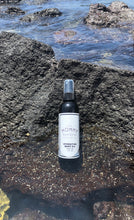 body oil on lava rock
