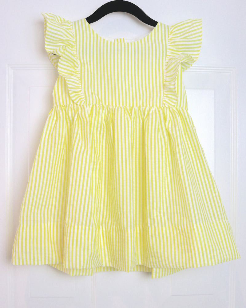 Madeleine Yellow Ruffle Dress by top childrens French fashion boutique, PetiBisou