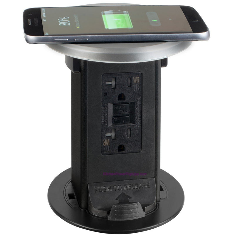Countertop Pop Up 20A GFI, Spill Proof, Wireless Charging Silver Top, Showing Phone Charging