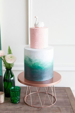 a cake champagne bar serve up sweets that incorporate the colors of the party such as this tiered bridal shower cake featuring chic watercolors
