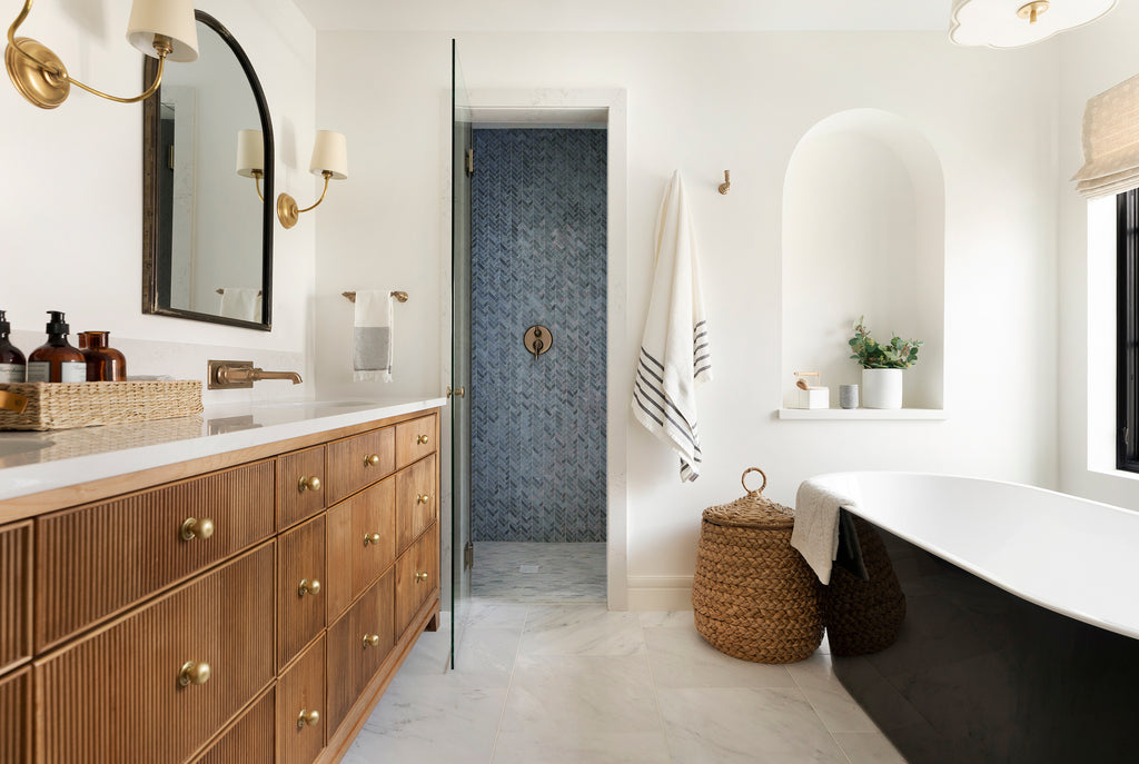 Neutral Bathroom with Wooden Cabinetry and Brass Handles