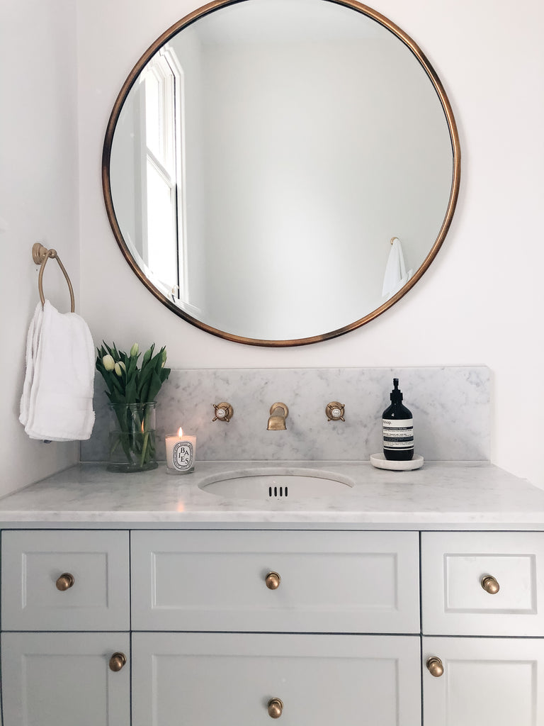 Bathroom Sink with Marble Top and Brass Hardware