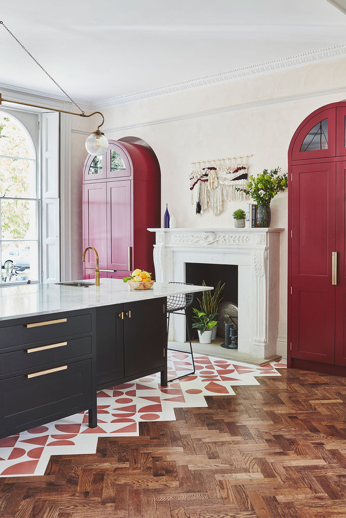 Kitchen with Black Island and Red Accents