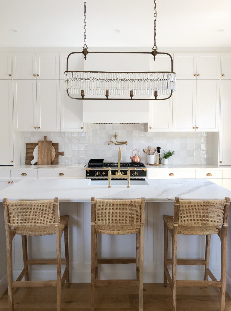White Kitchen with island and barstools