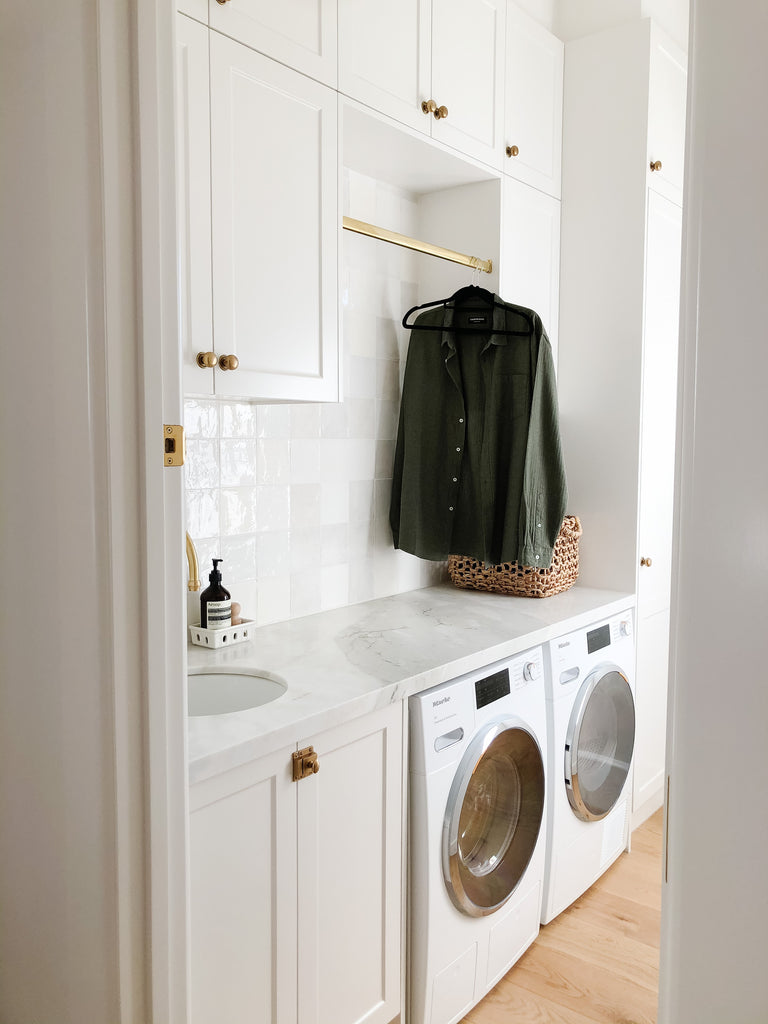 Neutral Utility Room with Brass Hardware