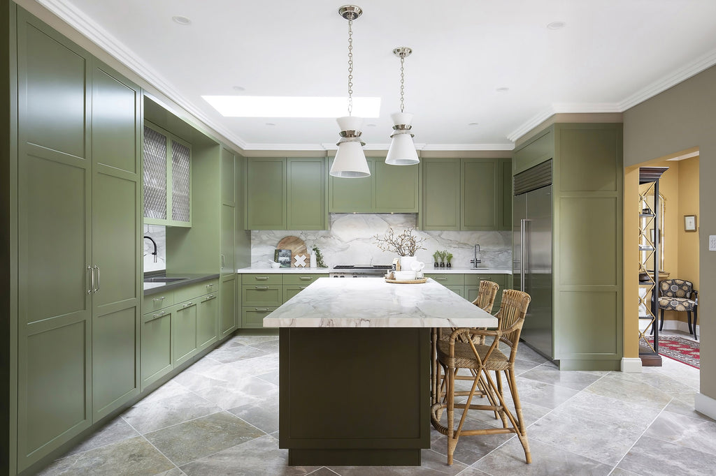 Green Kitchen with Marble Worktop and Wicker Chairs