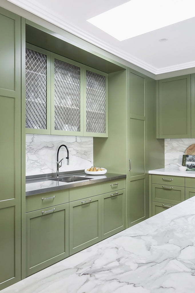 Green Kitchen with Marble Worktop and Silver Decorative Grille