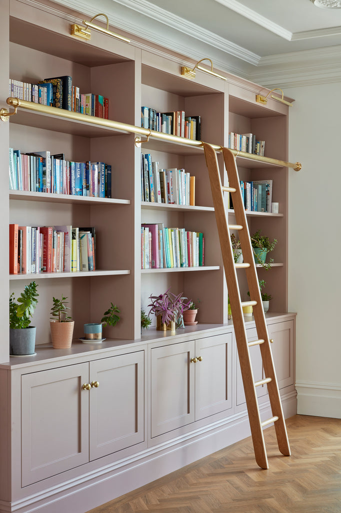 Pink Cabinet with Bookshelves and Brass Handles