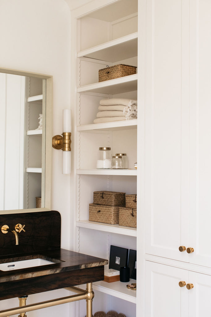 modern study shelves and cabinets with polished brass hardware