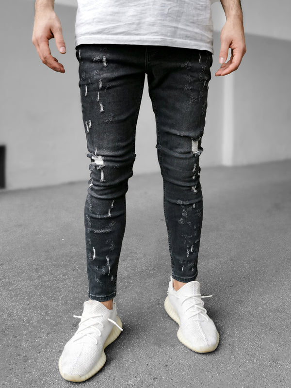 Skinny-Fit-Jeans mit Rissen. Verwaschene Optik. Elastisches Denim. Five-Pocket-Stil. Gürtelschlaufen. Verdeckte Metallknöpfe vorne. Black Island KA7 6974 3433 Grau Dunkelgrau Dark Grey