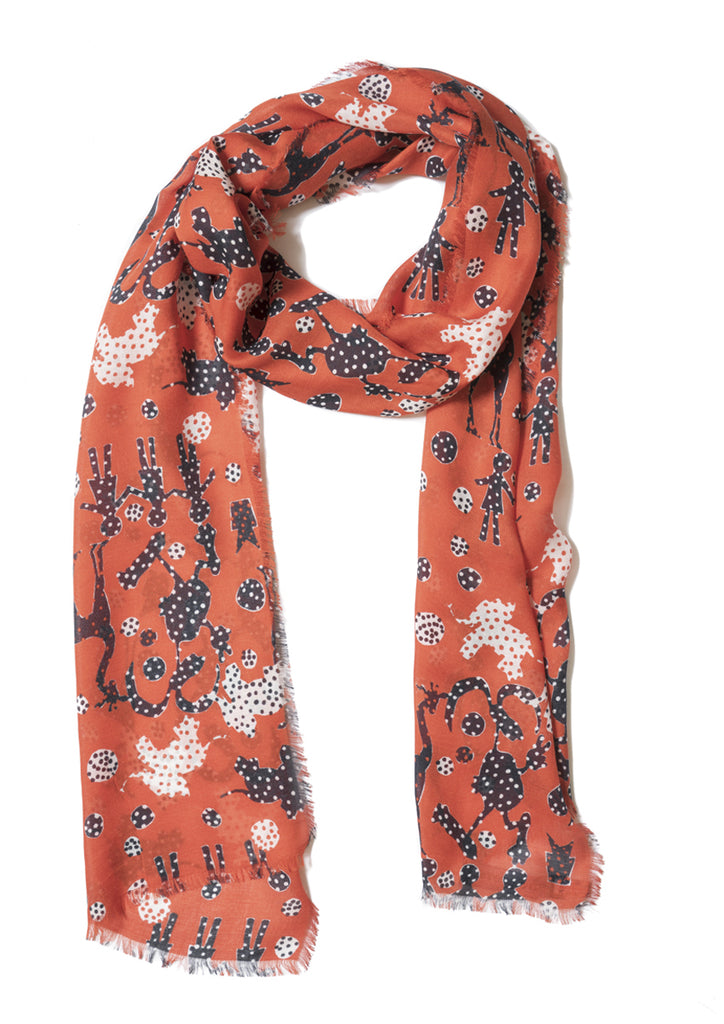 On red, patterned, cashmere modal scarf with fringed edge