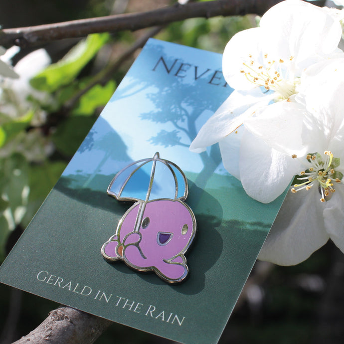 Hard enamel pin of an octopus holding an umbrella nestled within apple blossoms on a tree