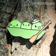 Peater at Sea enamel pin stuck to a tree, which is not the recommended way to wear them
