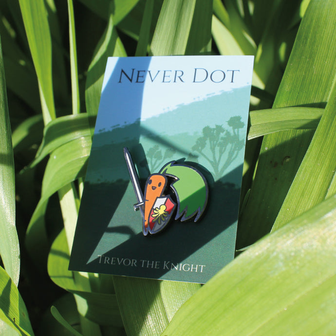 Carrot with sword enamel pin hiding among some leaves