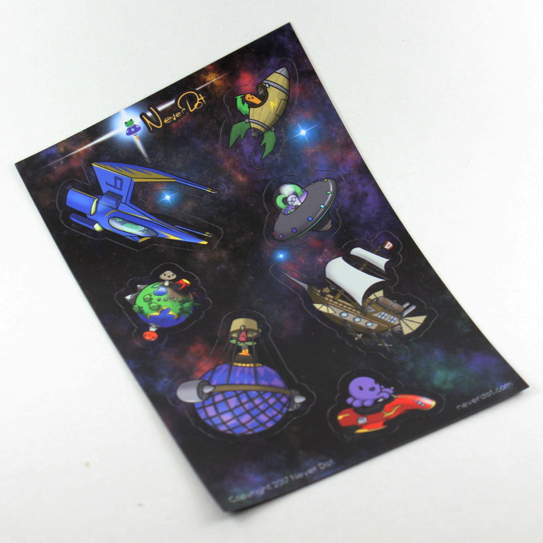 A magnet sheet showing 6 spaceships of different eras and technology levels and one tiny planet with two unexpectedly happy mushrooms inhabiting it