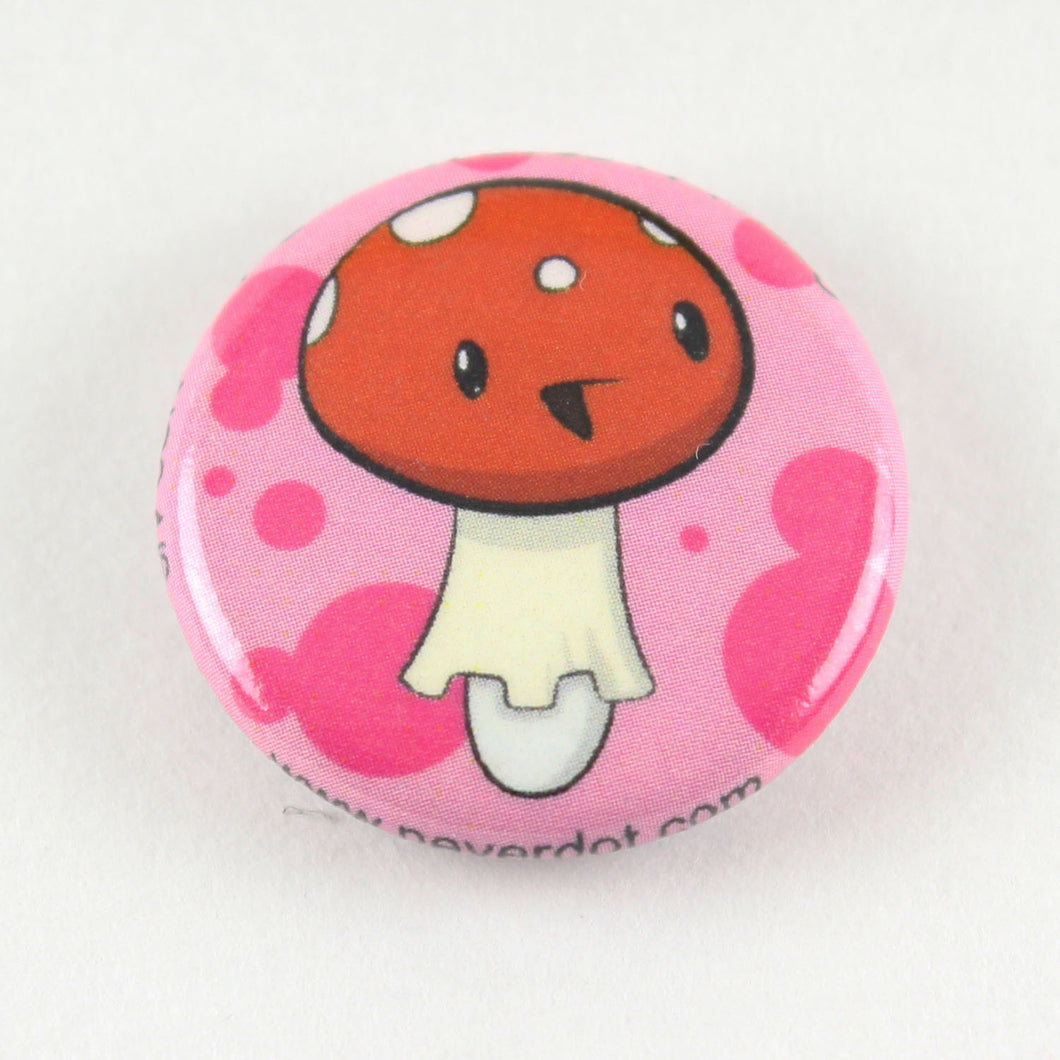 Magnet button showing a happy amanita mushroom, poisonous but sweet