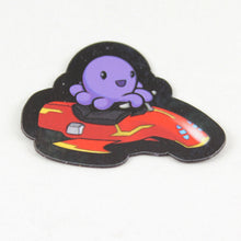 A magnet of an octopus riding a stylish speeder with side compartments storing a packed lunch for later