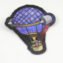 A magnet showing a beet manning a hot air balloon outfitted with a poorly thought out pair of jet engines attached