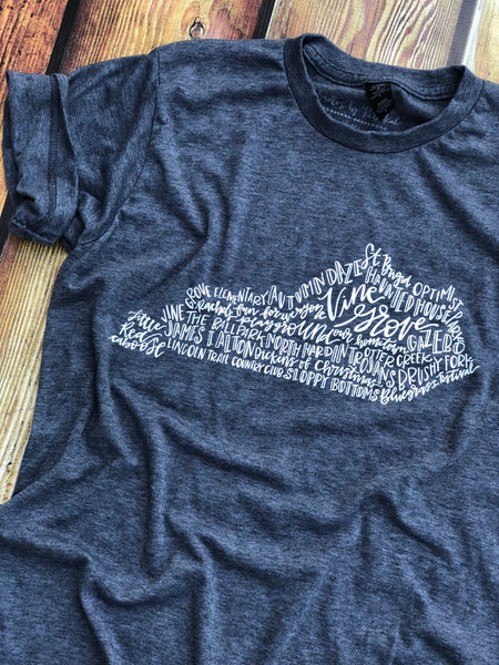 Vine Grove-Hand lettered-Graphic tee-unisex fit-women-mens-apparel-Dark Heather Gray-Bella Canvas-Screen Print-Vine Grove Kentucky-Kentucky-Small Town-Red Caboose-Autumn Daze-Haunted House-Rachels Playground-Bluegrass festival-Lincoln Trail Country Club-Our Hometown-Ballpark