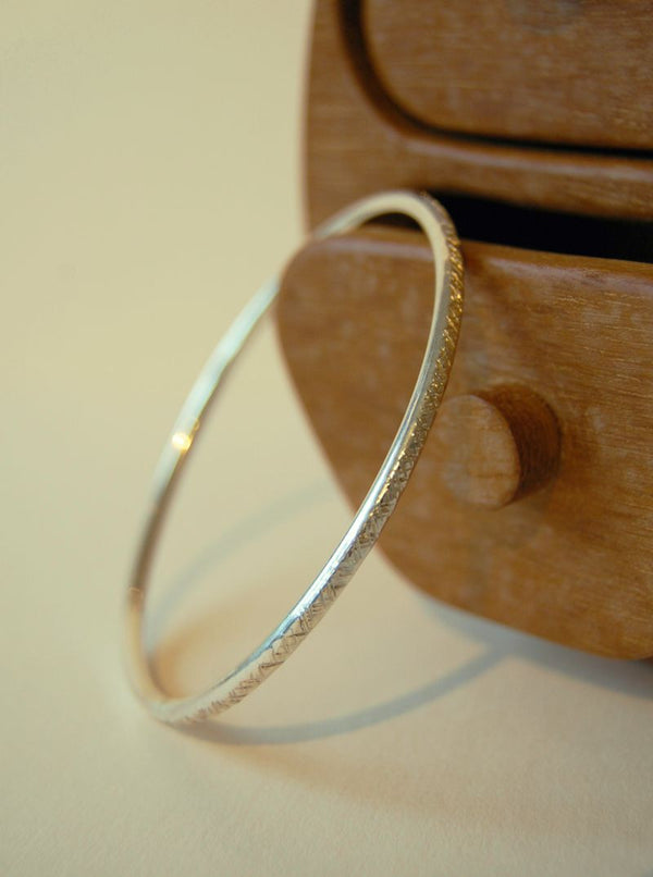 Amy R Lee criss cross silver bangle