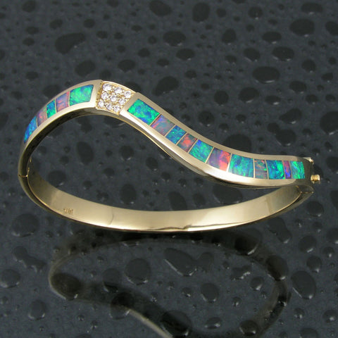 Curved Australian opal bracelet with diamonds in 14k gold by The Hileman Collection.