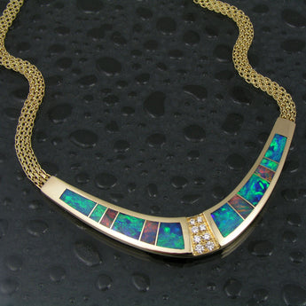 Elegant Australian opal necklace with diamonds set in 14k gold by Hileman.