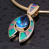 Australian opal pendant with a fantasy cut blue topaz and diamonds set in 14k gold