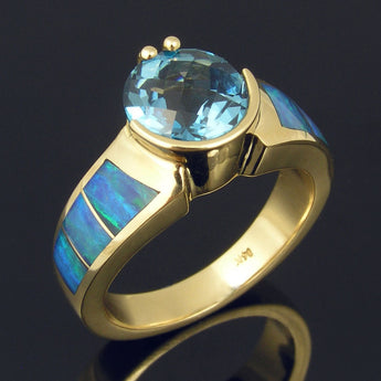 Australian opal ring with blue topaz set in 14k gold by Hileman