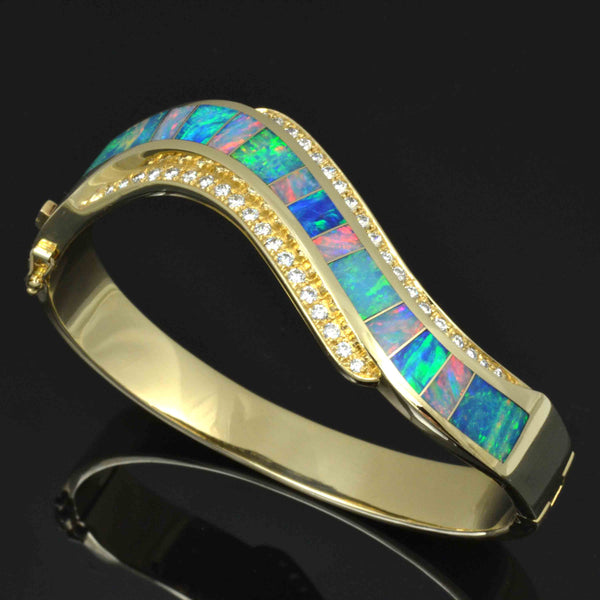 Australian opal bracelet with diamond accents in 14k gold by The Hileman Collection.