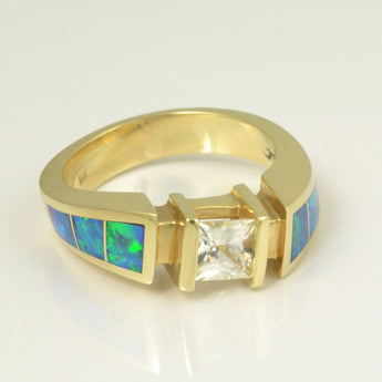 Opal and white sapphire ring in 14k gold.