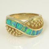 Australian opal ring with 8 pieces of opal inlay.