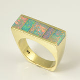 Flat top opal inlay ring in 14k gold.