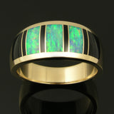 Man's black onyx and Australian opal wedding band in 14k gold by The Hileman Collection.