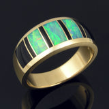 Man's black onyx and opal wedding ring in 14k yellow gold.