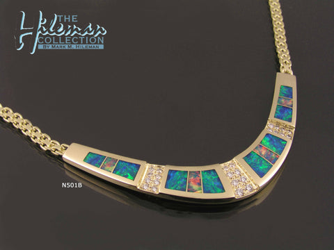 Fiery Australian Opal necklace with pave` set diamond accents handcrafted in 14k yellow gold by The Hileman Collection.
