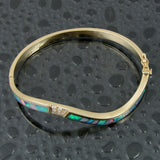 Diamond and opal bracelet in 14k gold by Hileman.