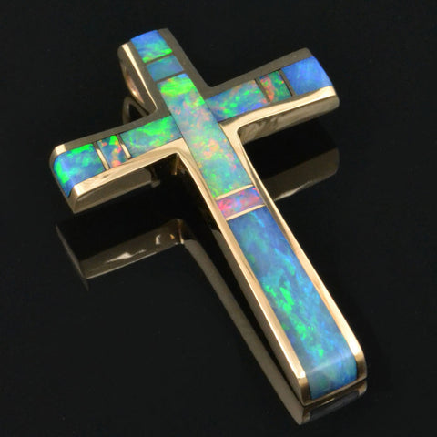 Australian opal cross pendant in 14k gold by Hileman