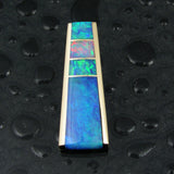 Opal inlay pendant in 14k gold