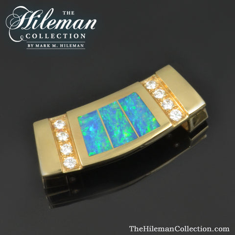 Australian opal slide pendant with diamonds in 14k gold.