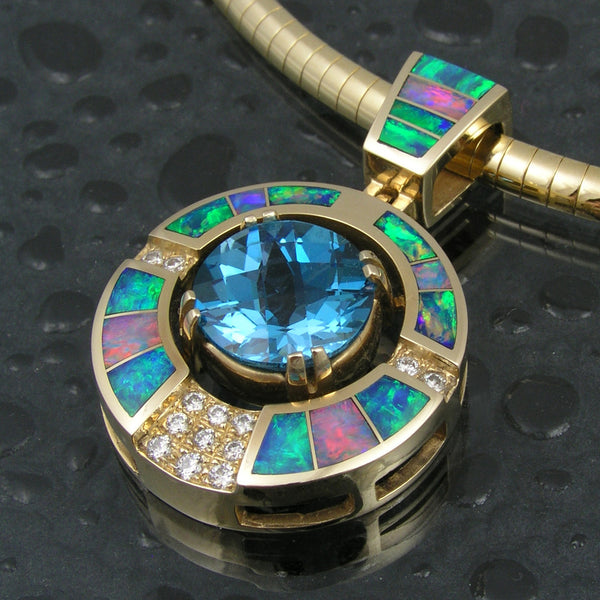 Australian opal pendant with blue topaz center by Hileman