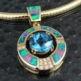 Topaz, diamond and opal pendant in 14k gold by Hileman.