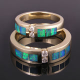 Australian opal wedding ring set with diamonds set in 14k gold by Hileman.